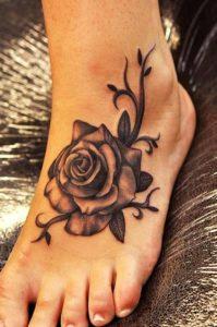 foot rose black  Tattoos for Girls ideas