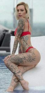 top girl tattoos on leg