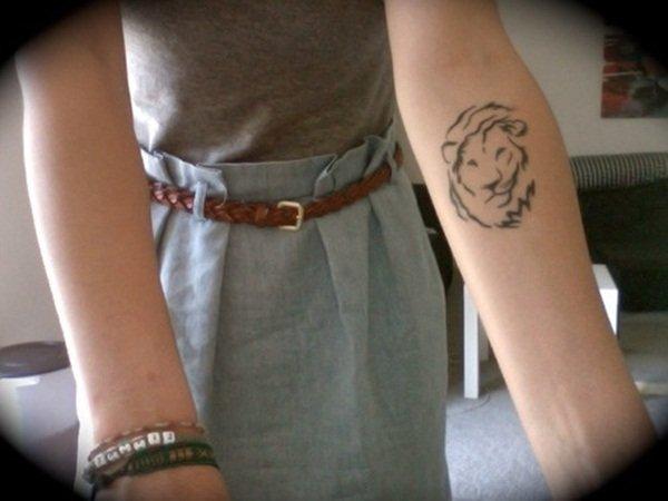 lion tattoo in hand