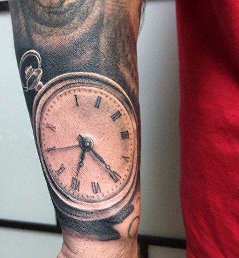 clock tattoo on shoulder and arm