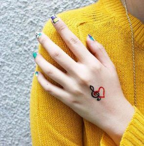 music note tattoo behind the ear