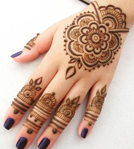 mandala flower mehndi henna tattoo design on arm for female