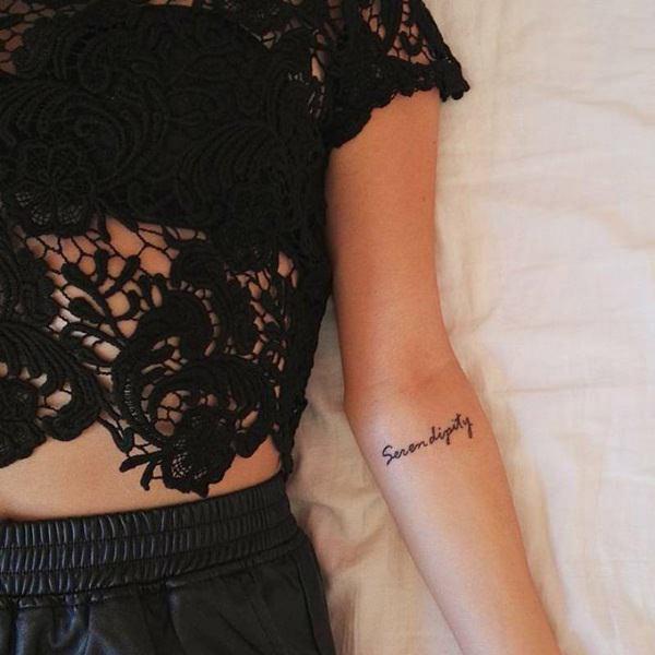 short sentences tattoo on female arm