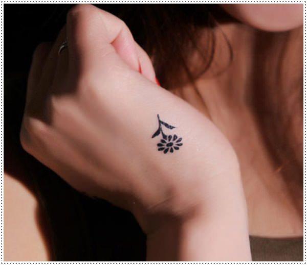 flower small tattoo on hand for girl design