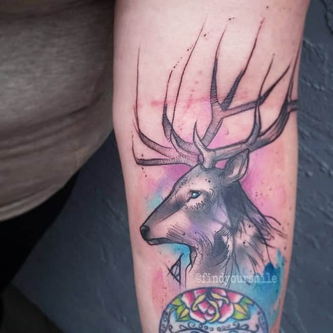 white deer tattoo on arm
