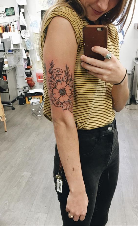 flower meaningful arm tattoos for females