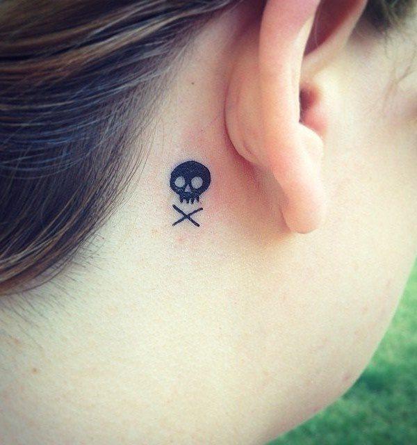 black small tattoo behind ear for female