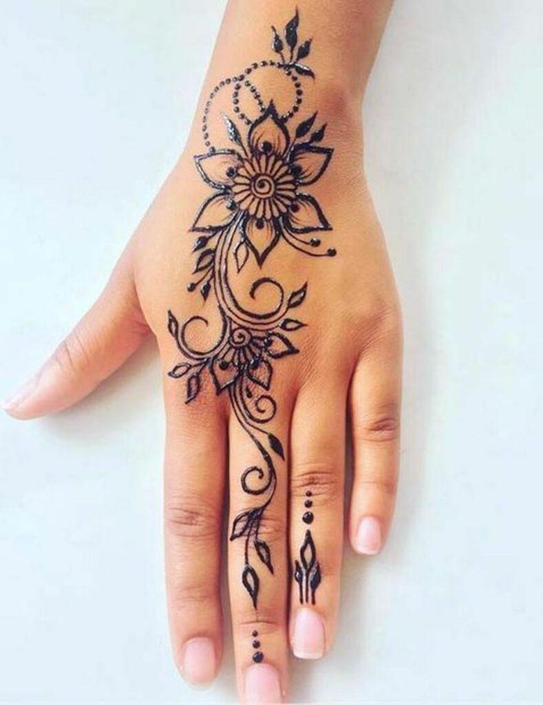 cute flower mehndi tattoo designs on hand and wrist