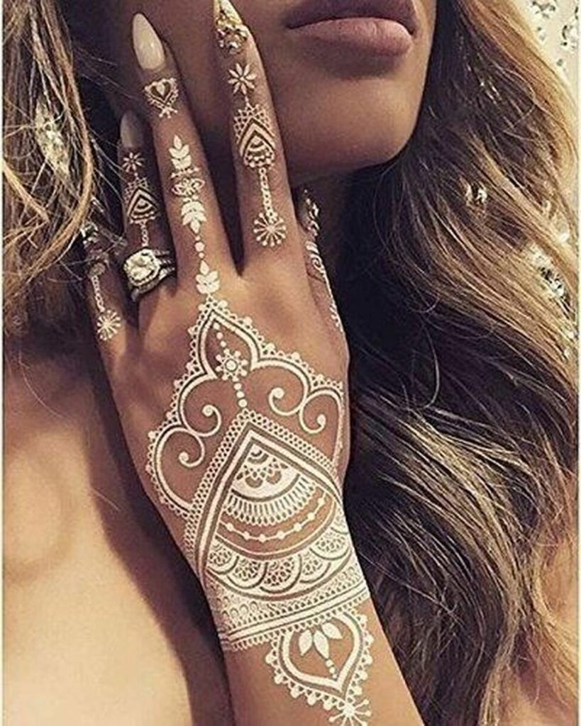 cool mehndi tattoo on women arm design