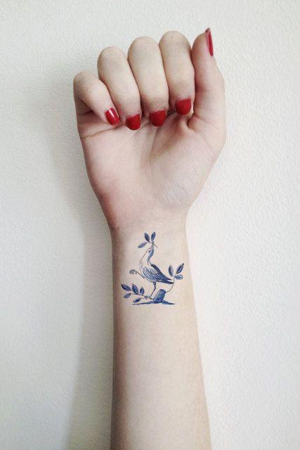 bird tribal wrist tattoos for ladies
