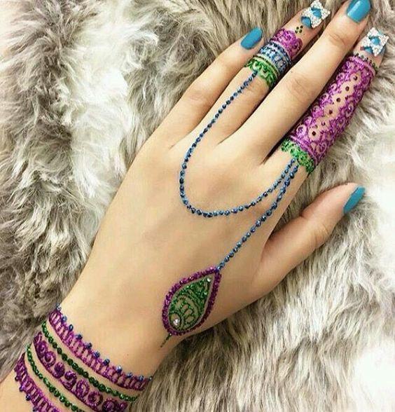 purple color tattoo mehndi design on finger and wrist