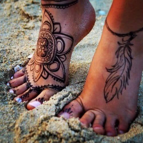 black color leg tattoo mehndi design for ladies