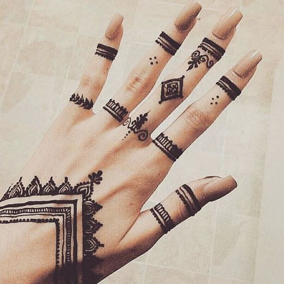 small symbols mehndi tattoo designs on hand pictures