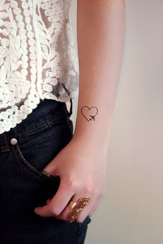 small plane best tattoo for girls on wrist