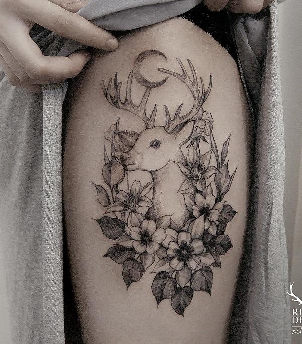 female deer tattoo on legs