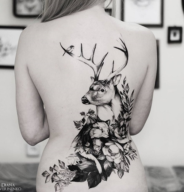 cool black deer silhouette tattoo on women back design