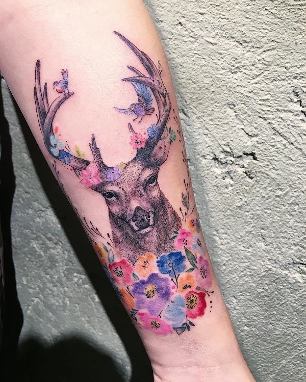 color native american deer tattoo on hand