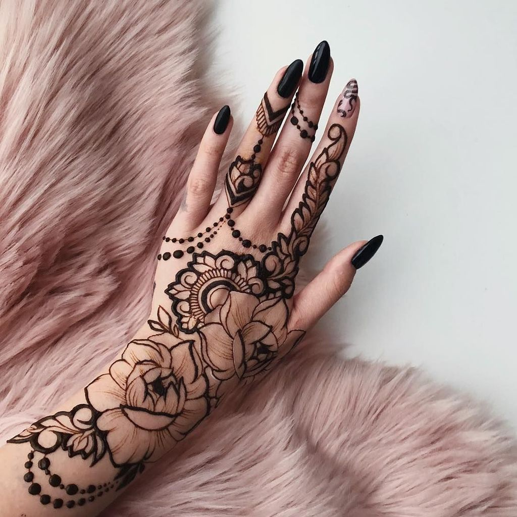 black color flower temporary mehndi body artwork for female