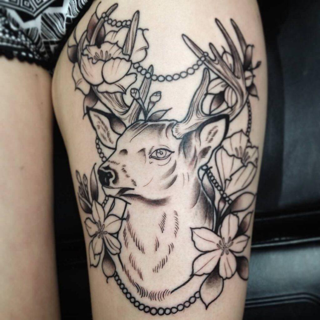 black deer dream catcher tattoo on ladies legs ideas