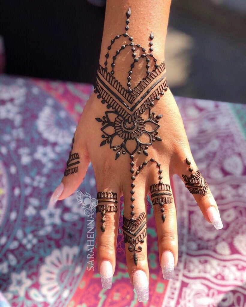 small flower tattoo mehndi design on hand images