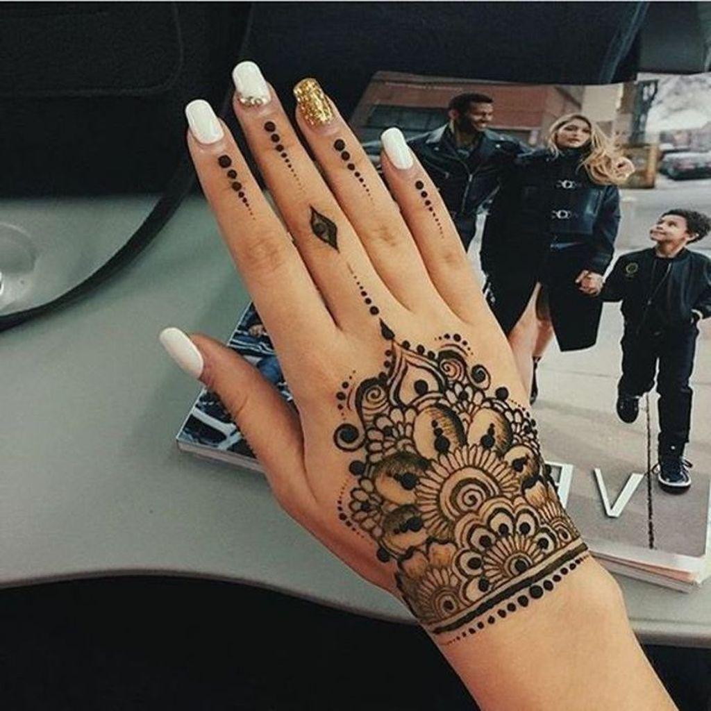 rose tattoo mehndi design on hand for women