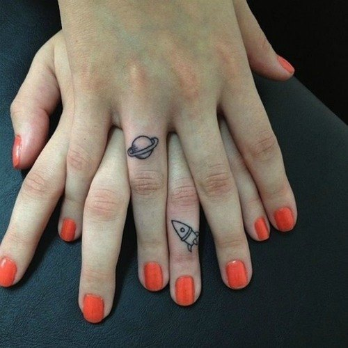 planet matching love tattoos for him and her fingers