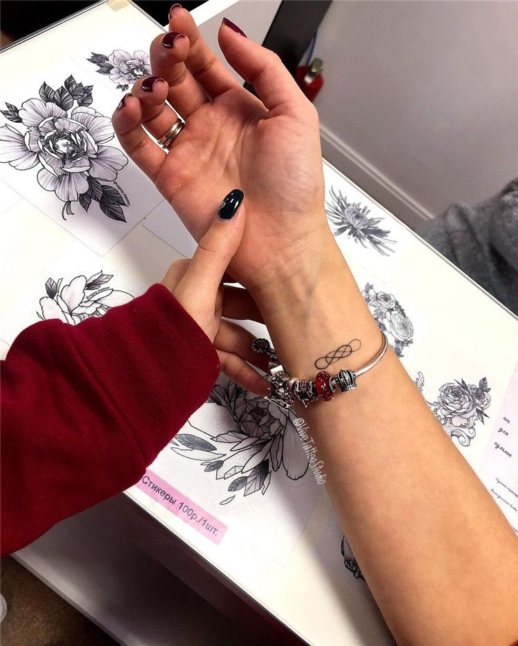 small dainty tattoos on wrist for female