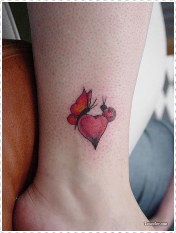 red little flower tattoos on women leg