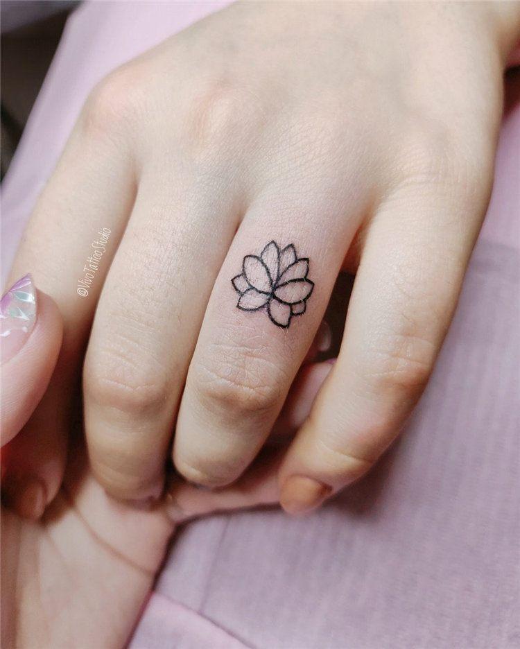 mandala flower small tattoo symbols on fingesr