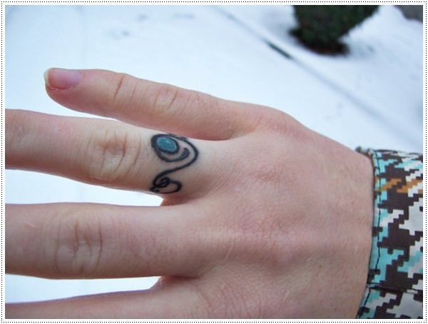 tiny meaningful tattoos on finger