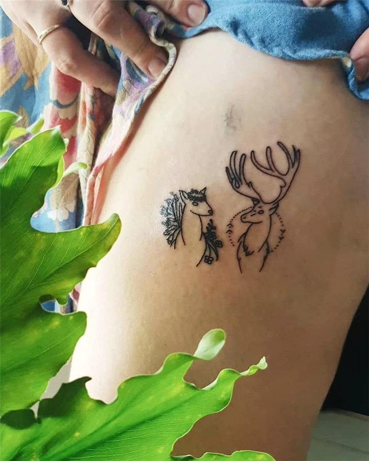 black small thigh tattoos for women