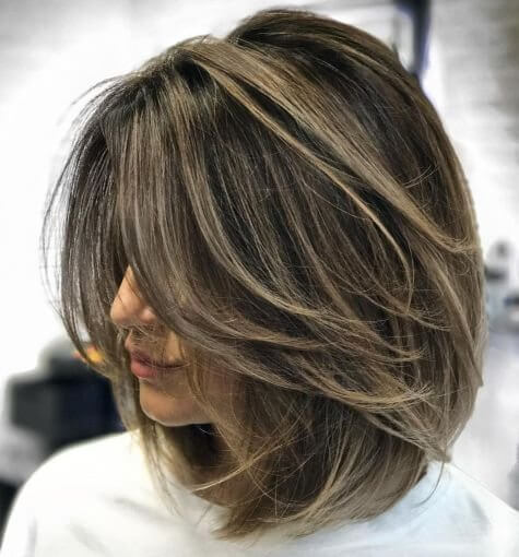pictures of womens short haircuts with layers one side