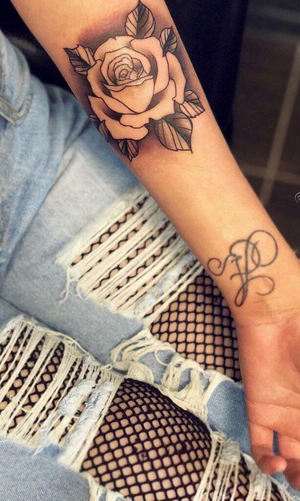 black rose best tattoo designs for women on arm