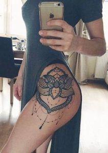 female rib tattoo ideas mandala flower symbols