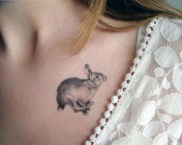 small rabbit unique tattoos for ladies on chest