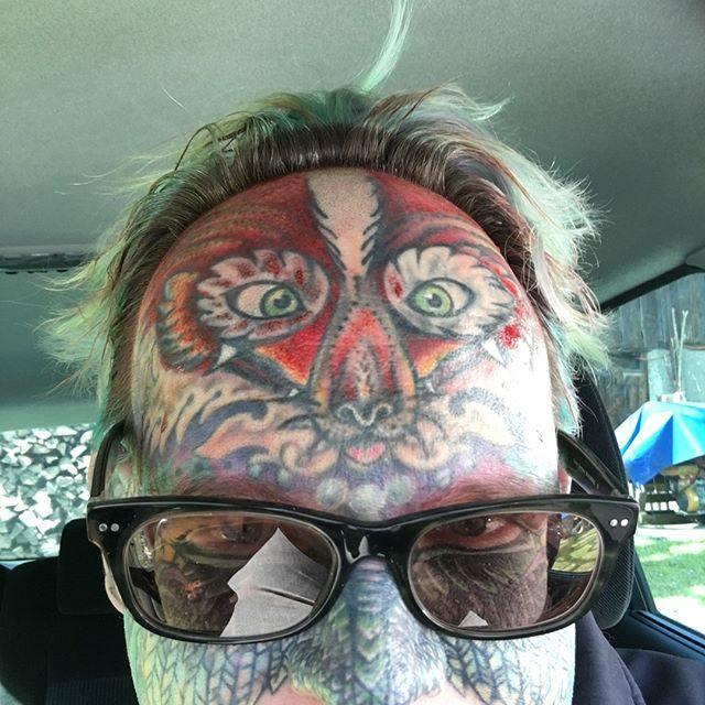 unique colorful best men's face tattoos images