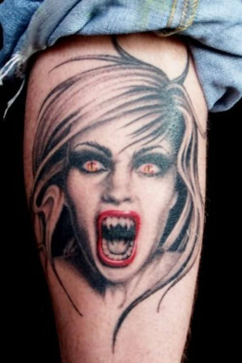 vampire teeth tattoo