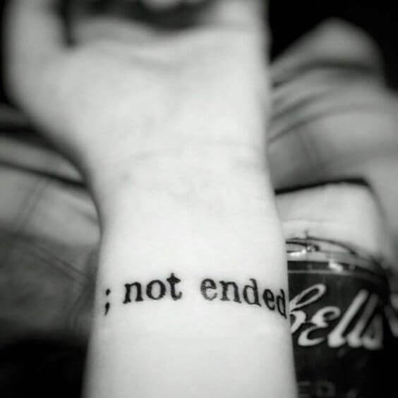 continue tattoo with semicolon letters design