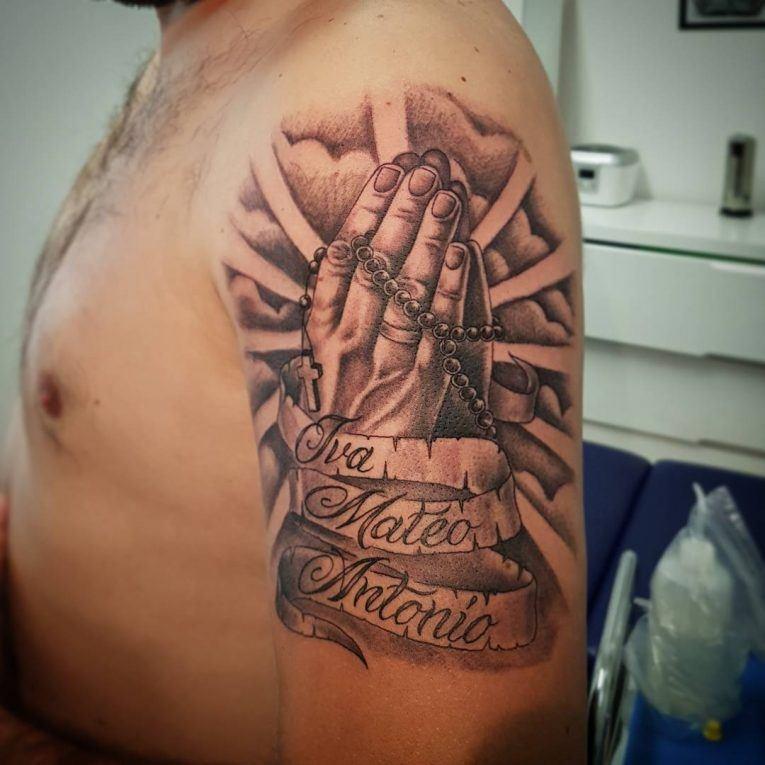 praying hands on forearm shoulder design