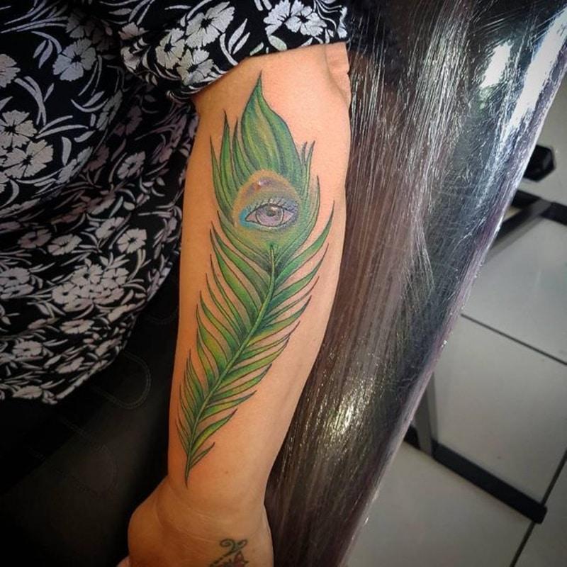 cool peacock tattoo on arm design