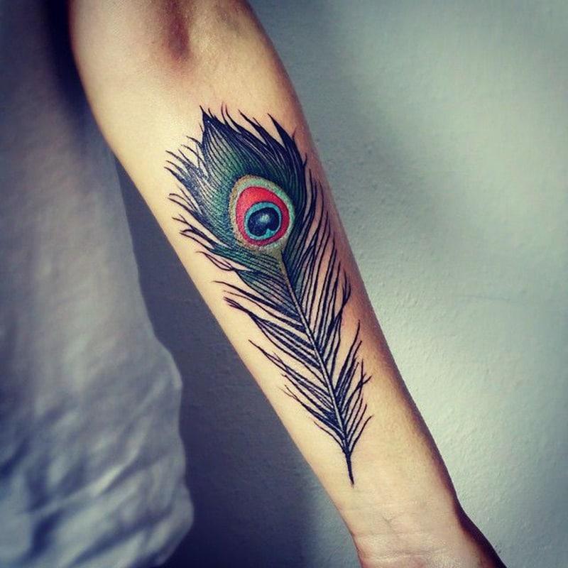 peacock tattoo  on women body