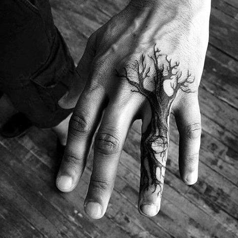 small tree design tattoos on the hand for guys