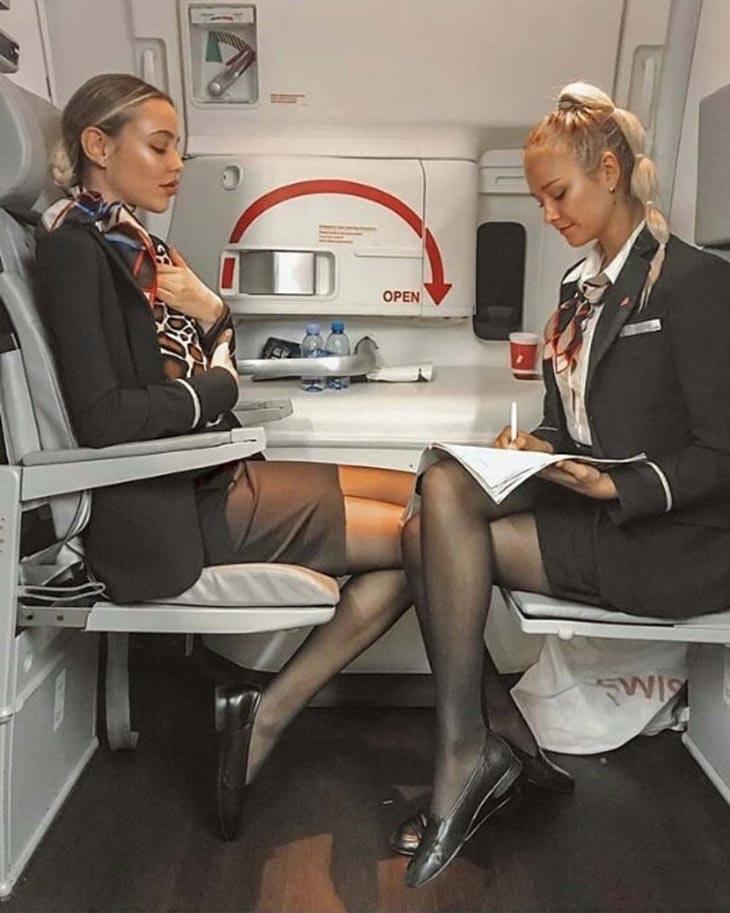cabin crew perfect body figure in plane