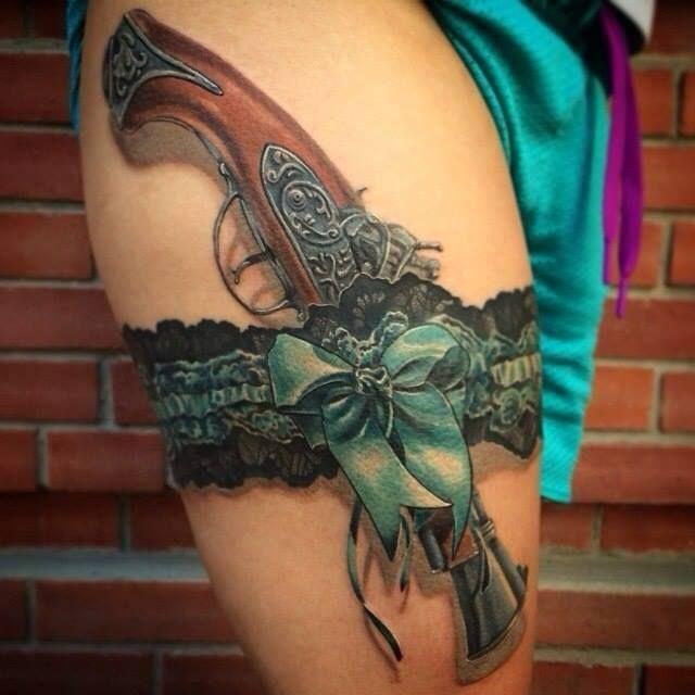 revolver tattoo design on women legs