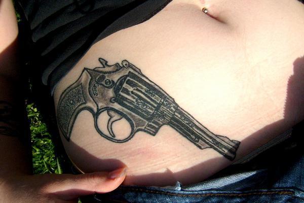 mini tattoo gun on female stomach design images