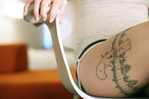 cool gun tattoos images