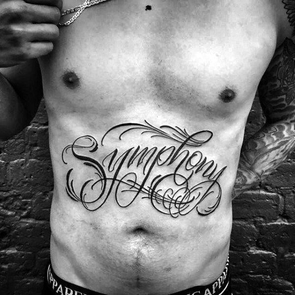 letters tattoo design on stomach