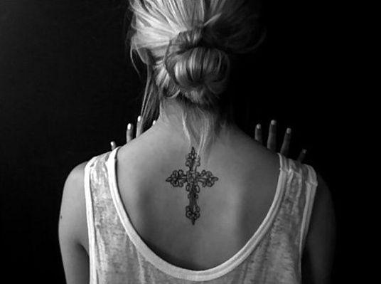 cross symbol feminine back tattoos designs