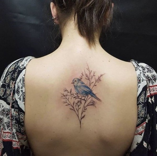 bird female lower back tattoo cover up