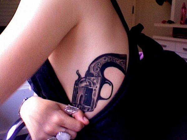 cool guns and inks tattoo on stomach side ladies design